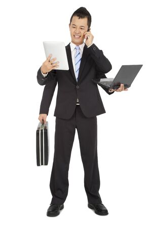 computer case: busy businessman holding mobile phone and laptop and tablet pc and briefcase Stock Photo