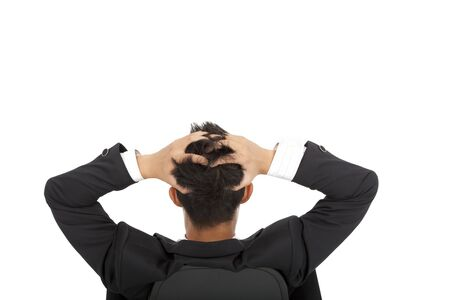 Stressed businessman holding head and sitting on the chair photo