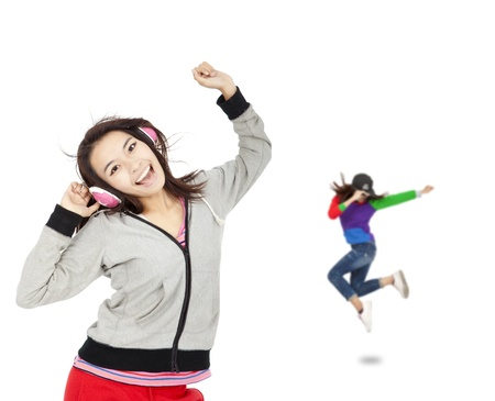 asian sport: happy asian young woman listen music and dancing