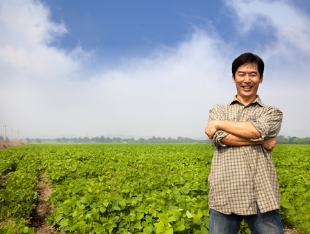 asian produce: successful  asian middle-aged farmer