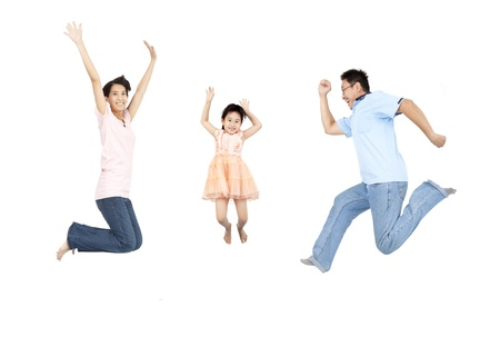 happy family jumping and isolated on white background photo