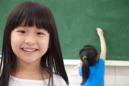 black children: happy asian student girls at school classroom  Stock Photo