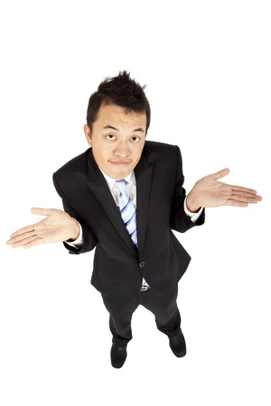 disinterest: asian  businessman shrugging and isolated on white