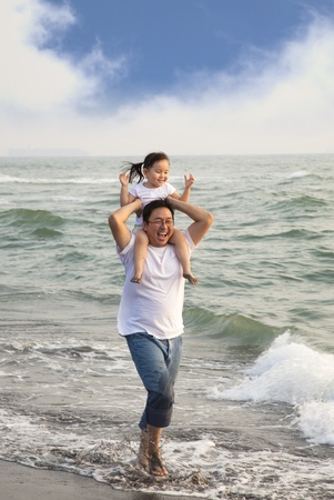 happy father with little girl on the beach photo