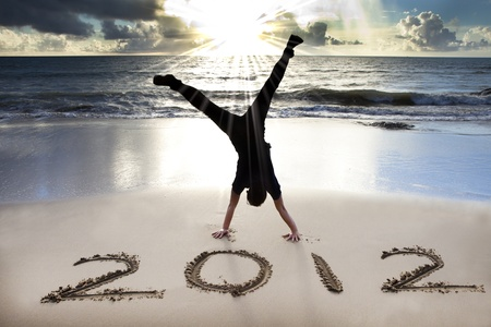 happy new year 2012 on the beach with sunrise  photo