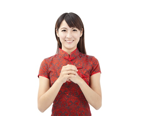 traditional clothes: happy chinese new year. beautiful young asian woman  with gesture of congratulation Stock Photo
