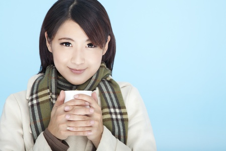 beautiful woman wearing winter clothing and holding coffee cup  photo