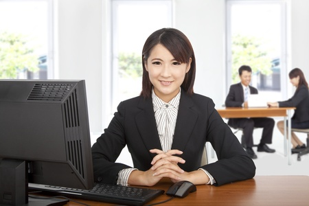 young office workers: Pretty asian  business woman at office desk with computer