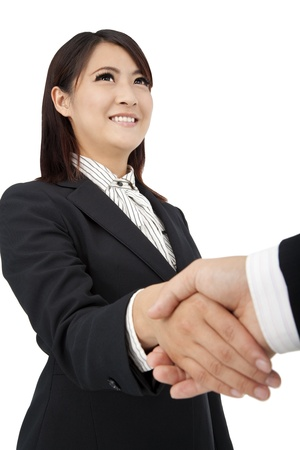 businesswoman handshaking with businessman and isolated on white photo