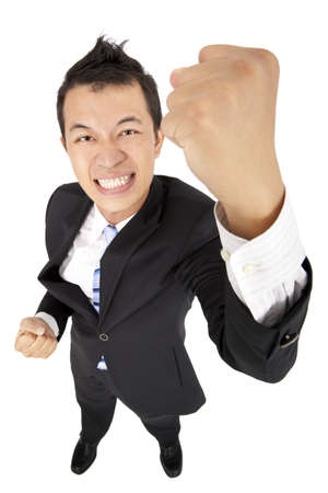 young asian business man with fist photo