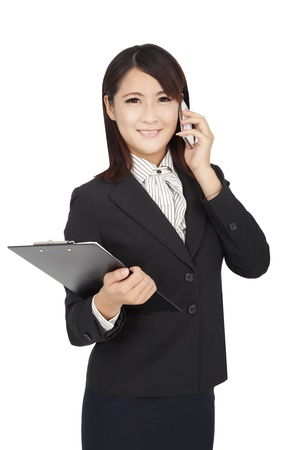 asian business woman using phone and holding a folder photo