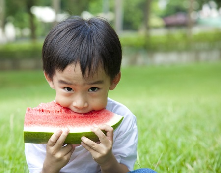 outsides: boy eating watermelon  Stock Photo