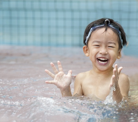 happy kid in the water