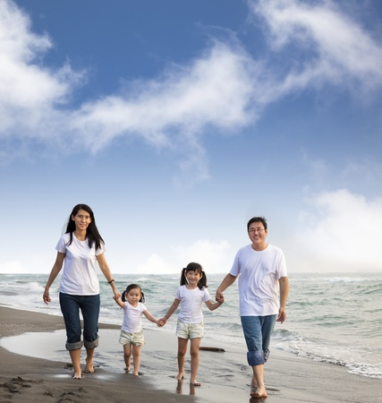 happy asian family: Portrait Of Family walking On the  Beach