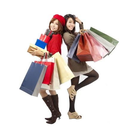 asian girl shopping: happy asian fashion girls holding shopping bag and gift box