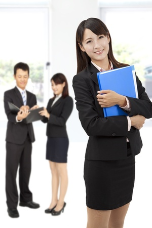 smiling  businesswoman in office photo