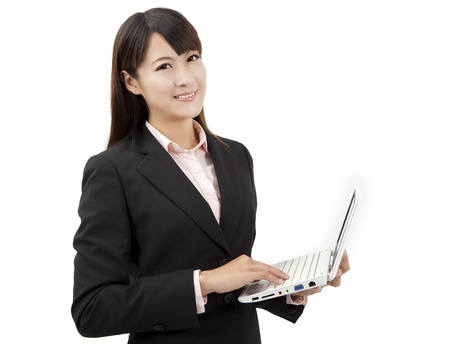smiling asian business woman holding laptop  Stock Photo - 11332018