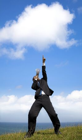 Businessman  holding megaphone with pointing the cloud  Stock Photo - 11332021