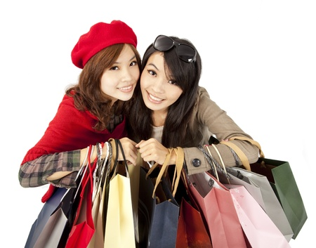 happy asian girls holding shopping bag  photo