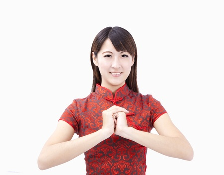 cheongsam: happy chinese new year. smiling young woman  with gesture of congratulation