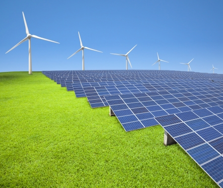 solar panels and wind turbines on the grass field photo