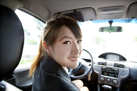 smiling business women in her car