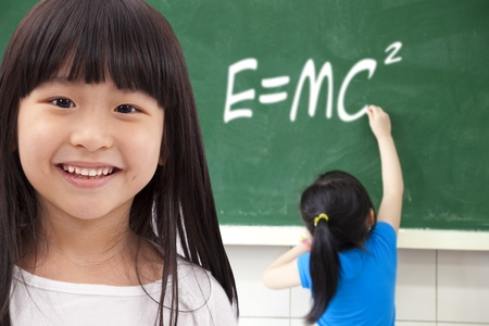 happy girls  by chalkboard with e=mc2 photo