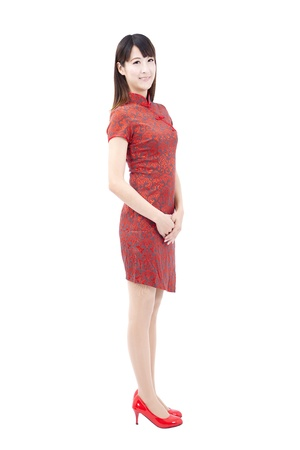 Chinese  woman with traditional clothing  cheongsam and isolated on white photo