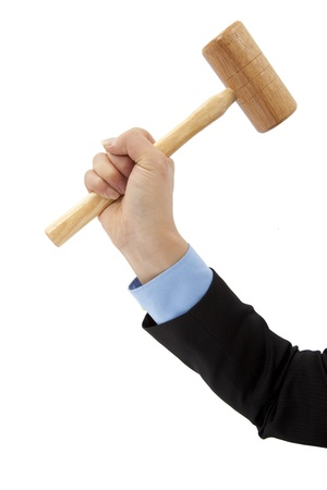 hand of businessman holding hammer isolated on white background photo