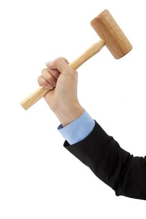 hand of businessman holding hammer isolated on white background photo