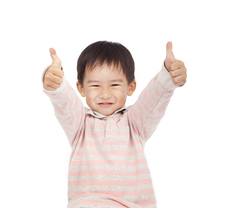 kid friendly: asian boy giving you thumbs up isolated on white background