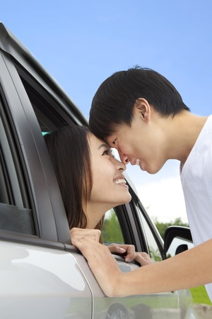 romantic couple looking at each other in the car photo