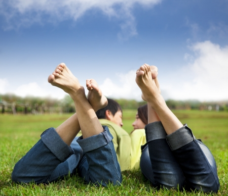 relaxed couple lying on the grass photo