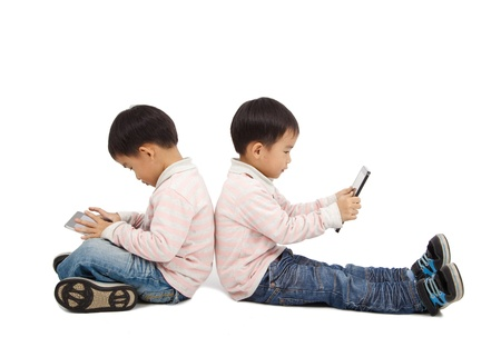 pad: boys using touchscreen tablet PC  and isolated on white