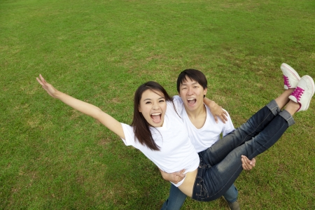 happy asian couple on the grass photo