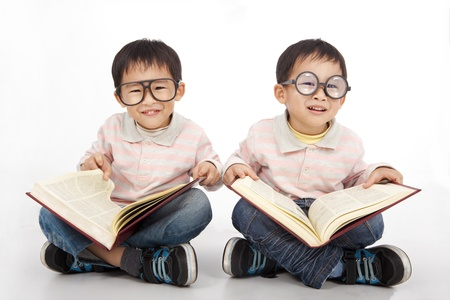 Happy kids with big book wearing black glasses photo