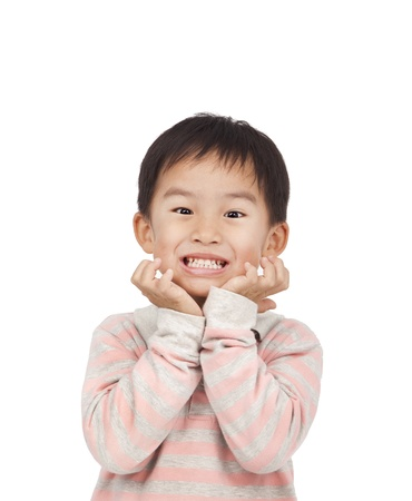 asian kid expressing surprise with his hands in his face photo