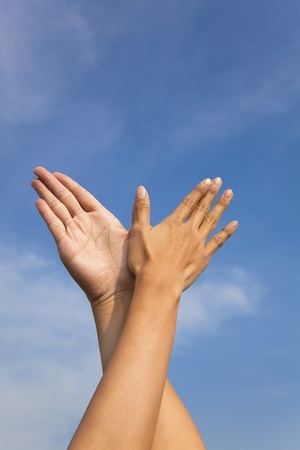bird hand gesture in the blue sky photo