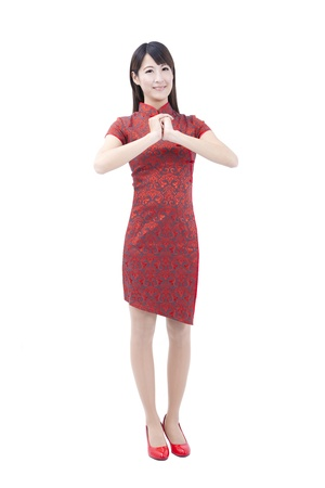cheongsam: happy chinese new year.young asian woman  with gesture of congratulation