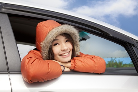 young woman in a car with winter wear photo