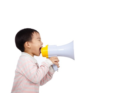 asian kid shouts something into the megaphone photo