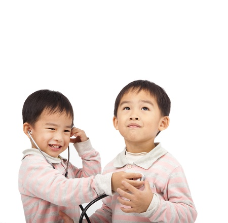 two kids with health examination by stethoscope