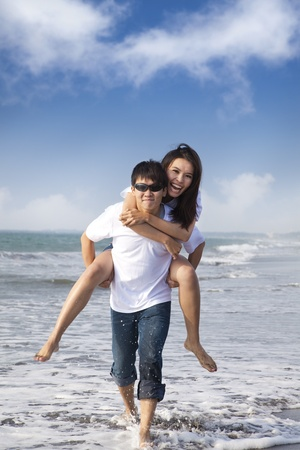 Asian Couple in love enjoy  summer holiday on the beach photo
