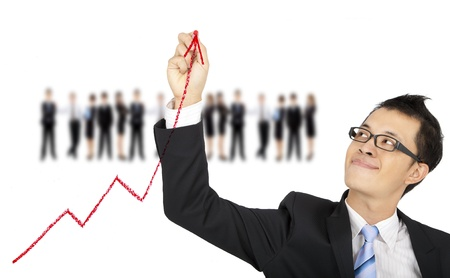 growing success: businessman drawing business graph by red chalk