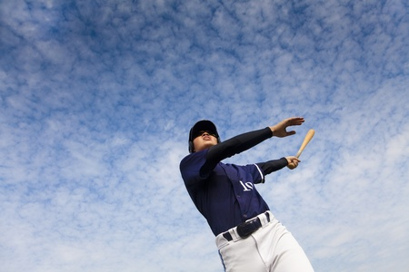 young baseball player taking a swing  Stock Photo