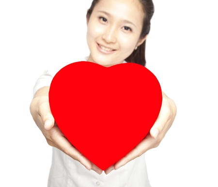 young woman holding red heart symbol photo