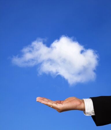 cloud computing concept. hand of businessman hold a cloud photo