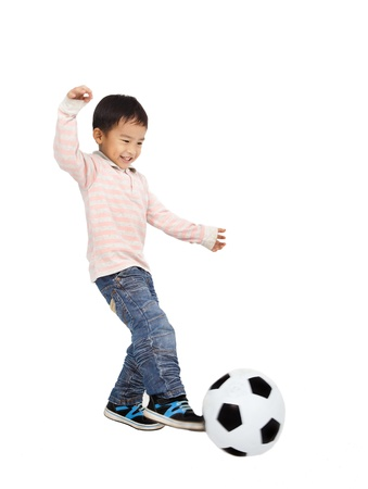 happy asian boy playing soccer isolated on white background photo