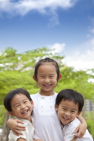 three happy asian kids photo