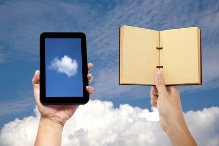 hand holding book and tablet pc with cloud computing concept photo